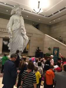 Students get a closer look at the plaster model of the Statue of Freedom that sits atop the U.S. Capitol.